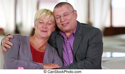 Mature relationship - Happy senior couple embracing and...