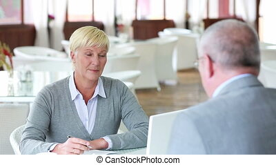 Vacant position - Mature businesswoman listening attentively...