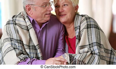 Moments together - Happily married senior couple enjoying...