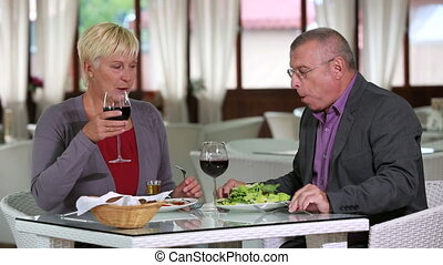 Lunch - Couple of seniors having a healthy lunch together