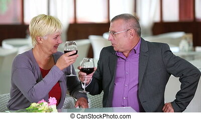 Drink your health - Seniors enjoying wine in a restaurant
