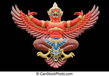 Red garuda statue isolated on black background