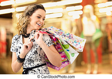 Lady in the shopping mall - Photo of young joyful woman with...
