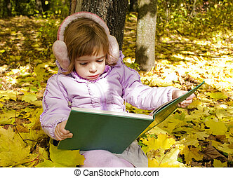 girl reads a book