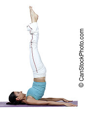 young woman doing the shoulder stand in yoga