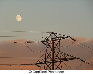 Moon and Pylon - Moon and electricity pylon at dusk,...