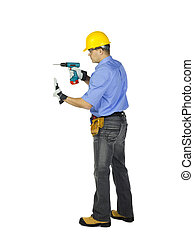 man in safety gears holding electric drill machine -...