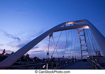 Modern bridge on the sunset