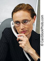 Business woman makes a call