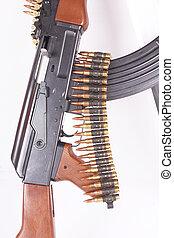 AK-47, bandoleer and sword - A Russian AK-47, a bandoleer of...