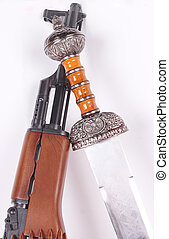 AK-47 and sword - A Russian AK-47 and a roman sword