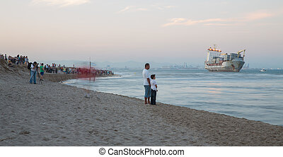 Merchant Ship - VALENCIA - OCTOBER 1: People observes Celia...