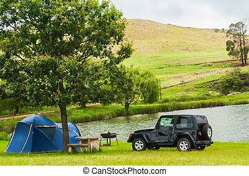Camping by the pond in the wild.