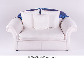 Couch - A huge couch with three cushions and blue throw