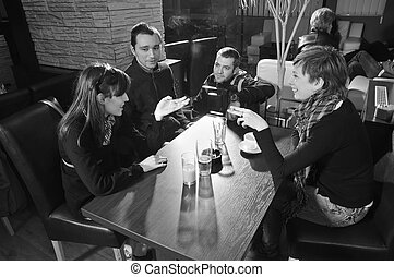 Cafe - Young people sitting in cafe and talking