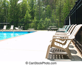 Swim Deck - Row of adirondack chairs on a pool deck
