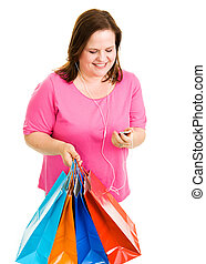 Shopping and Tunes - Pretty plus-sized woman holding her...