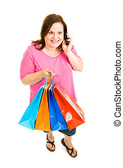 Shopping and Talking - Pretty plus-sized woman holding her...
