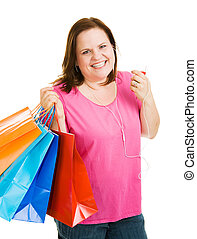 Shopping with Music - Pretty plus-sized woman shopping and...