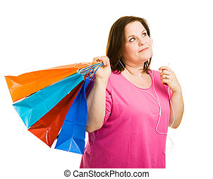 Music and Shopping - Pretty plus-sized woman shopping and...