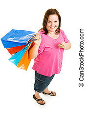 Shopping with MP3 PLayer - Pretty plus-sized woman shopping...