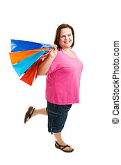 Happy Plus-Sized Shopper - Beautiful plus-sized model enjoys...