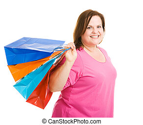 Happy Shopper - Happy plus sized model holding shopping bags...