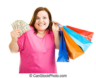 Shopping Spree - Beautiful plus-sized model holding cash in...