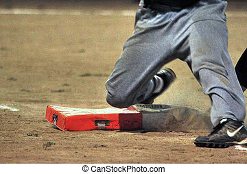Back on first - Amateur baseball player who is safe at first...