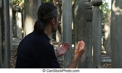 pray - Muslim man praying  friends at graveyard