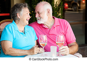 Senior Couple - Wine and Romance - Senior couple flirting...