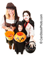 Halloween Trick Or Treaters Isolated - Three children in...