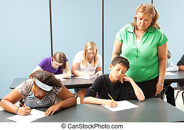 Teacher Monitors Standardized Test - Teacher supervising...