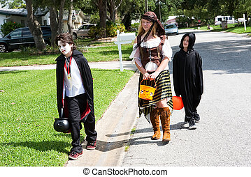Neighborhood Kids Trick or Treat - Children in Halloween...