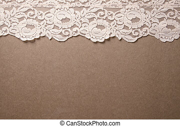 Pink Vintage Lace Trim - Light pink lace trim sits on a...