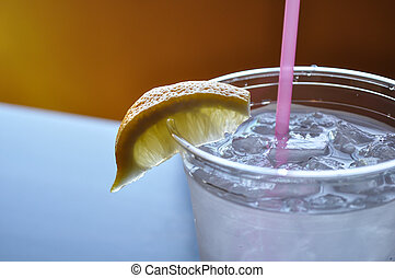 close up of ice water with lemon