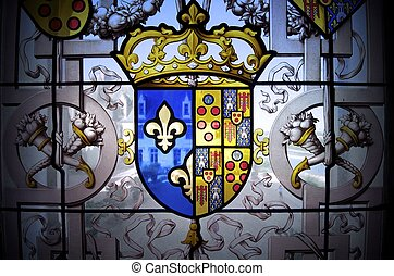 coat of arms - closeup of a coat of arms in a window of the...