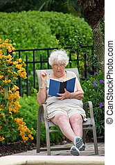 Woman Reading Book - Senior Woman Reading Book Outside...