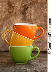 Coffee Mugs - Colorful coffee mugs over an obsolete grunge...