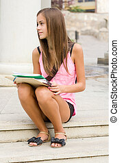 Beautiful teen student girl. - Outdoors portrait of a...