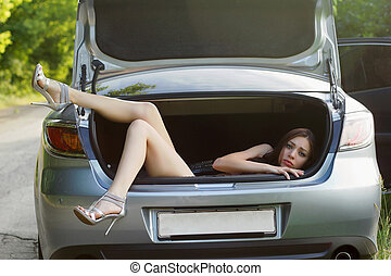 young woman in the trunk of car - Sexy young woman in the...
