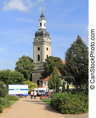The market square and Trinity church in Genthin, Germany -...