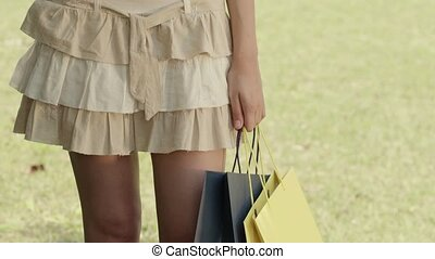 Happy teen with shopping bags