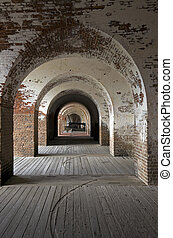 Fort Pulaski in Georgia. Cannon seen at the end of arch...