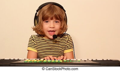 little girl play music on keyboard