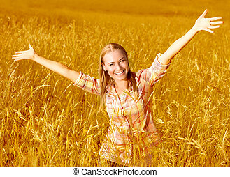 Cheerful girl on wheat field - Picture of happy cheerful...