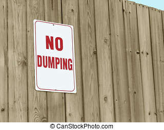 No Dumping - Sign posted on wooden fence