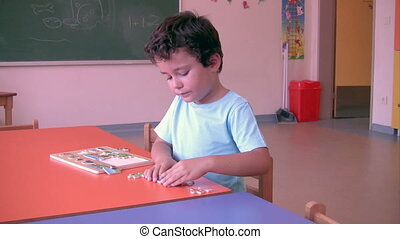 Preschool Student solving puzzle in the classroom