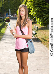 Beautiful teen student girl - Outdoors portrait of a...