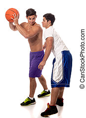 Basketball Players - Male basketball players. Studio shot...